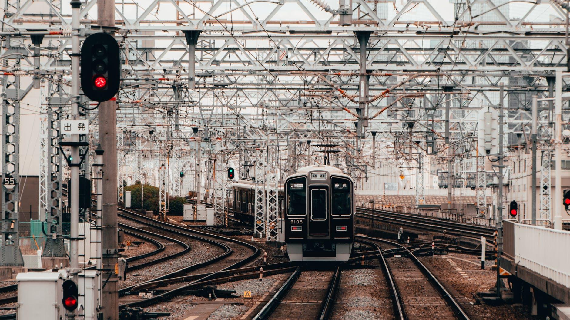 black and gray train on rail tracks
